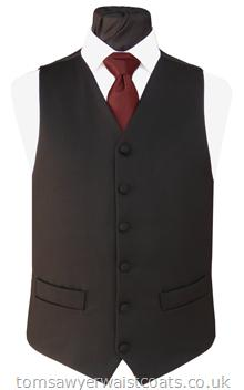 This smart black waistcoat is made from 100% wool. It has 2 pockets. Waistcoat Style- TS116- Front Fabric- 100% Wool twill- Colour- Black- Buttons- Fabric Covered- Back & Lining- Black Polyester- You can click here to view our waistcoat size chart.