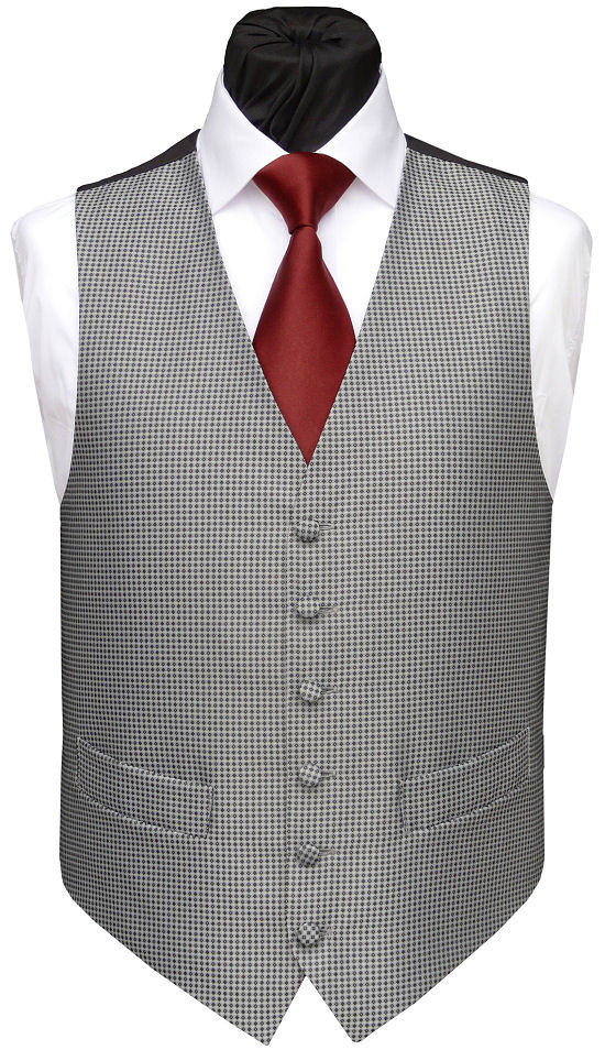 This traditional wedding waistcoat features our low neck classic cut in a timeless, stylish silver grey pattern. Waistcoat Style- TS249- Front Fabric- Knightsbridge non-silk- Colour- Black and Grey- Buttons- Fabric Covered- Back & Lining- Black Polyester- You can click here to view our waistcoat size chart.