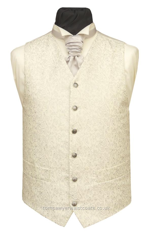 Ivory cotton waistcoat with metallic silver swirls. Waistcoat Style- TS276- Front Fabric- Cotton- Colour- Ivory with Silver- Buttons- Silver pattern- Back & Lining- Light Ivory Satin- You can click here to view our waistcoat size chart.