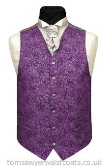 Purple cotton waistcoat with metallic silver swirls. Waistcoat Style- TS277- Front Fabric- Cotton- Colour- Purple with Silver- Buttons- Silver pattern- Back & Lining- Silver Satin- You can click here to view our waistcoat size chart.