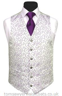 The purple woven swirl design on this waistcoat is mirrored by the swirl background. Waistcoat Style- TS311- Front Fabric- Rumours (non-silk)- Colour- Purple- Buttons- Silver patterned- Back & Lining- Ivory Satin- You can click here to view our waistcoat size chart.