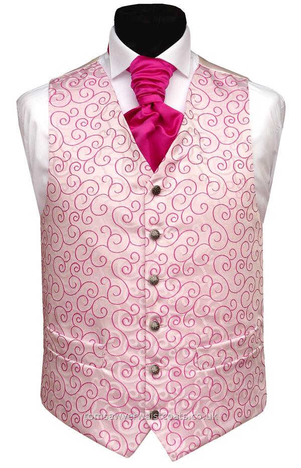 The cerise woven swirl design on this waistcoat is mirrored by a swirl design on the background. This waistcoat is available in extra large sizes and extra length ensuring that big or small, short or tall, your wedding group will be able to match. Waistcoat Style- TS310- Front Fabric- Rumours (non-silk)- Colour- Cerise Pink- Buttons- Silver patterned- Back & Lining- Ivory Satin- You can click here to view our waistcoat size chart.