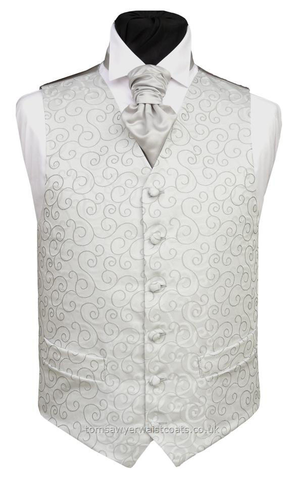 The woven swirl design on this waistcoat is mirrored by the swirls on the silver grey background. Waistcoat Style- TS089- Front Fabric- Rumours (non-silk)- Colour- Silver- Buttons- Fabric covered- Back & Lining- Silver Satin- - You can click here to view our waistcoat size chart. -