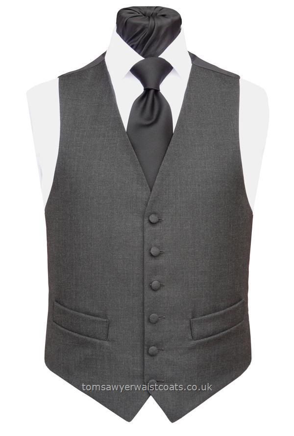 A Charcoal Grey mens waistcoat featuring our Classic cut. Waistcoat Style- TS250- Front Fabric- 45% Wool/55% Polyester Twill- Colour- Charcoal Grey- Buttons- Grey covered- Back & Lining- Black Polyester- You can click here to view our waistcoat size chart.