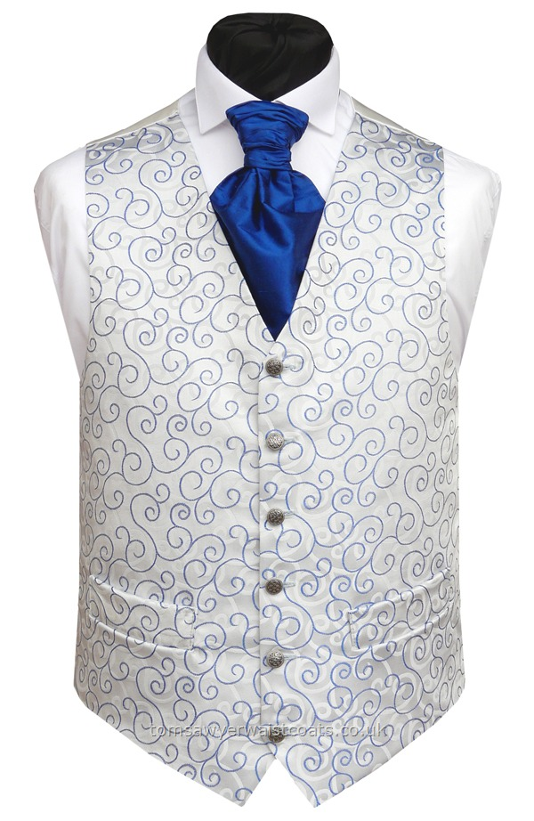Royal Blue waistcoat with a woven swirl design mirrored by the swirl background. As with many of our wedding waistcoats we can make this style in extra large sizes and extra long fitting to accommodate everyone in your wedding party. - Waistcoat Style- TS089-BLUE- Front Fabric- Rumours (non-silk)- Colour- Blue- Buttons- Silver patterned- Back & Lining- Ivory Satin- -You can click here to view our waistcoat size chart.