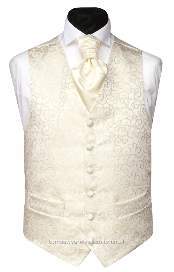 A rich cream woven swirl design mirrors the ivory swirl background of this wedding waistcoat. Extra large sizes waistcoats and ext,ra length waistcoats are all made in this style ensuring that your entire wedding group will look the part for your big day. Waistcoat Style- TS089-CREAM- Front Fabric- Mixed Fibres (Man Made)- Colour- Rich Cream on Ivory- Buttons- Fabric covered- Back & Lining- Ivory Satin- -You can click here to view our waistcoat s....