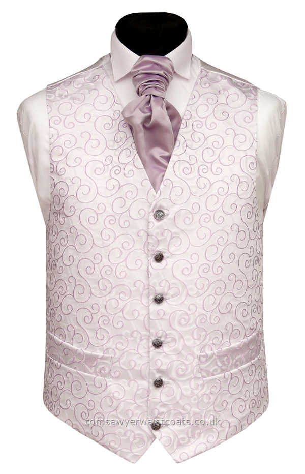 The woven lilac swirl design on this waistcoat is mirrored by the swirls on the background. AS with most of our waistcoats, this waistcoat is made to order so that if you need extra large sizes or extra length waistcoats or boys waistcoats to match the men, all sizes are available. Waistcoat Style- TS089-LILAC- Front Fabric- Rumours (non-silk)- Colour- Lilac- Buttons- Silver patterned- Back & Lining- Ivory Satin- -You can click here to view our w....