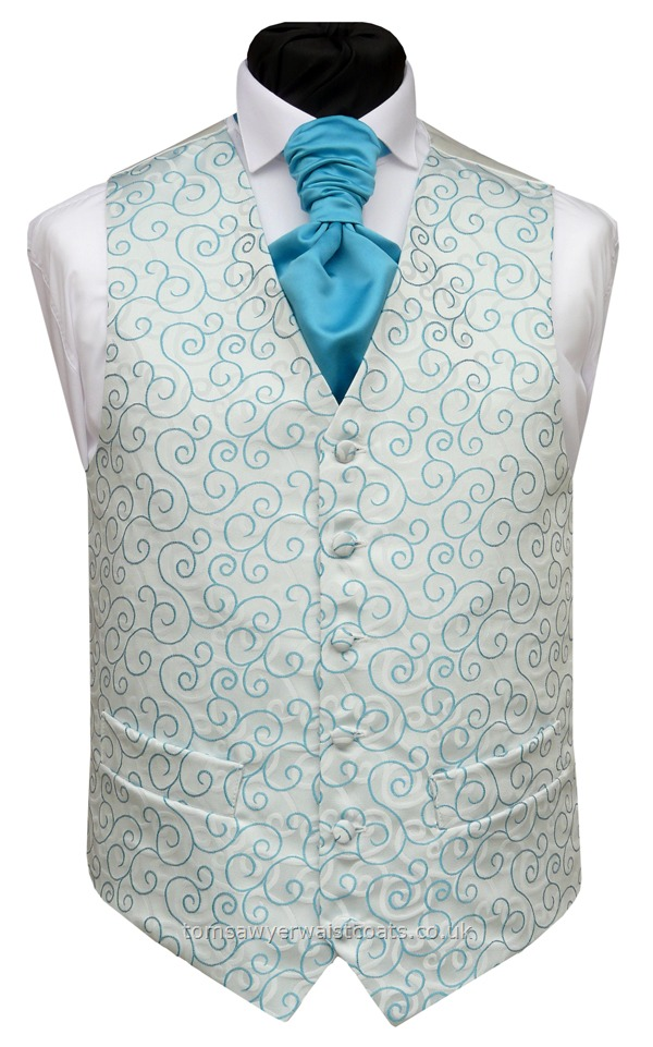 Turquoise woven swirl design mirrored by the swirl background. We didn't know how to name the colour of this waistcoat as it compliments many different colours, including shades of teal, aqua, peacock, spearmint, kingfisher and 'tiffany blue'.This waistcoat will suit a wide range of neckwear colours. The main photograph shows a Kingfisher (DW) Satin scrunchie tie. Click on 'more images' to see the waistcoat paired with Spearmint (CG) satin and Te....