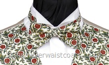 A morris-inspired traditional pattern of poinsetta and foliage on a rich cream background. Style- Ready Tied Bowtie- Fabric- Cotton- Colour- Red/green on rich cream- - - - -
