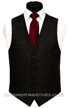 This charcoal grey tweed waistcoat is made from 100% pure new wool, woven in the UK. The waistcoat is a classic low neck style with a breast pocket. Waistcoat Style- TS387- Fabric- 16oz wool tweed- Colour- Charcoal Grey- Buttons- Fabric covered- Back & Lining- Black Polyester- You can click here to view our waistcoat size chart.