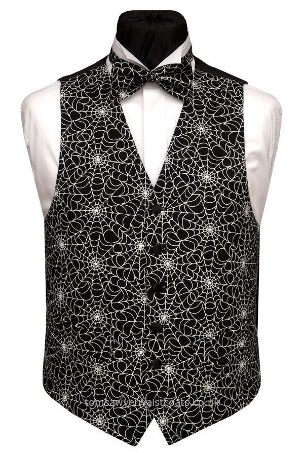 The spider web pattern on this black waistcoat will glow in the dark! Waistcoat Style- TS390- Front Fabric- Cotton- Colour- Black/white- Buttons- Black Satin- Back & Lining- Black Polyester- - - You can click here to view our waistcoat size chart.