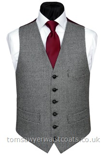 This black and grey dogtooth waistcoat features a contrast burgundy back and lining in our smart 'changeant' two-tone black and burgundy twill. Waistcoat Style- TS407- Front Fabric- Dogstooth blended wool- Colour- Black, grey- Buttons- Black Leather- Back & Lining- Black/Burgundy 'Changeant' Polyester Twill- Please choose the size you require. You can click here to view our size chart to help you decide.
