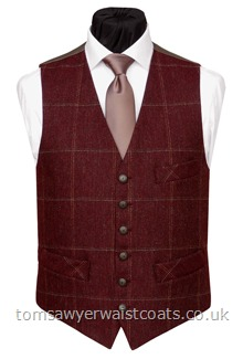 100% Wool British Tweed, woven in Yorkshire.Burgundy with brown, stone and cream checks and a ginger 'changeant' two tone twill back and lining. -Featuring a lower cut, shaped neckline and additional breast pocket. Waistcoat Style- TS417- Front Fabric- 100% Wool Tweed- Colour- Burgundy, Brown, Stone & Cream- Buttons- Patterned Brass Effect- Back & Lining- Ginger 'Changeant' Polyester Twill- - You can click here to view our waistcoat size chart.