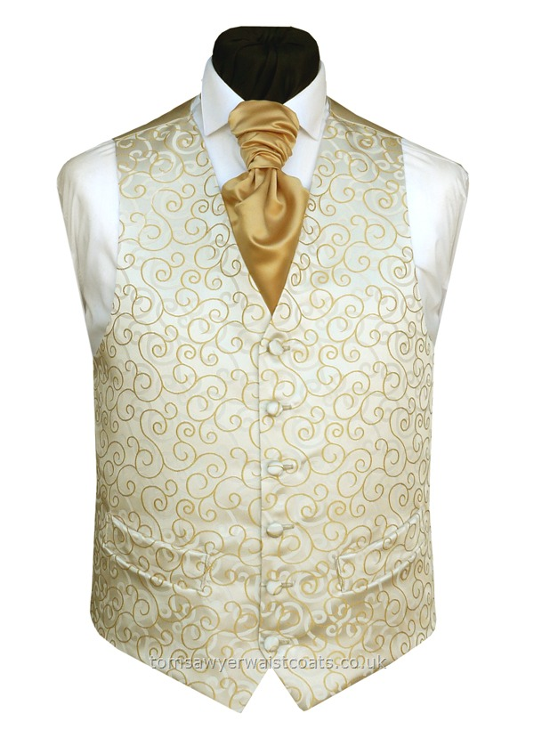 A woven gold swirl mirrors the pale gold swirl background on this wedding waistcoat. As with many of our waistcoats, this style is available in extra large sizes and extra length to ensure that big or small, short or tall, we can supply matching waistcoats for your wedding. Waistcoat Style- TS089- Front Fabric- Rumours (non silk)- Colour- Gold- Buttons- Rumours fabric covered- Back & Lining- Rich Cream Satin- - You can click here to view our size....