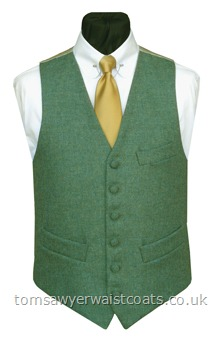 This sea green tweed waistcoat has a subtle herringbone weave and is made from 100% pure new wool, woven in the UK. Waistcoat Style- TS393- Fabric- 16oz wool tweed- Colour- Sea Green- Buttons- Fabric covered- Back & Lining- Rich Cream Satin- You can click here to view our waistcoat size chart. Featured Shirt: Club Collar Shirt with Collar Bar-