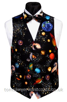 The sky at night/big bang waistcoat. A galaxy of planets, moons, satellites and stars pulsating on a black background. Just one size 38'' Chest regular fitting waistcoat available from stock at this HOT OFFER price. Waistcoat Style- TS359-HO- Front Fabric- Cotton- Colour- Multi coloured pattern on black- Buttons- Black satin covered- Back & Lining- Black Polyester- -
