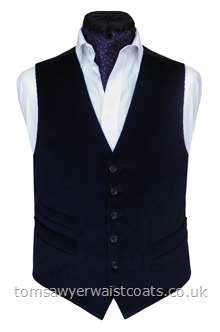 A quality smart/casual waistcoat in navy blue corduroy, featuring a small coin or pocketwatch pocket set above the standard working pockets. Featuring a lower cut, shaped neckline. Waistcoat Style- TS460- Front Fabric- Corduroy- Colour- Navy- Buttons- Navy Horn Effect- Back & Lining- Navy Polyester Twill- Please choose the size you require. You can click here to view our size chart to help you decide.
