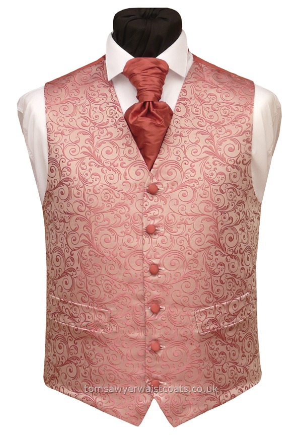 This Jacquard waistcoat features swirls of salmon and classic pink and has a pure Silk Dupion back and lining in Regency pink. Cut in our traditional high neck style with two working pockets. - Waistcoat Style- TS430- Front Fabric- Regency Jacquard non-silk- Colour- Regency Pink- Buttons- Silk fabric covered- - Front Lining-& Back- - Regency pink silk dupion- You can click here to view our waistcoat size chart.