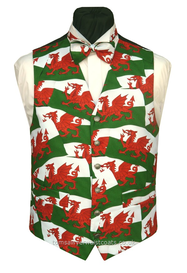 Fly the flag with this unusual Wales patriotic design, with matching bowtie available to purchase separately. Wear this Welsh Red Dragon waistcoat with pride. - Waistcoat Style- TS426- Front Fabric- Cotton- Colour- Red on Green & White flag design- Buttons- Silver coloured- - Back & Lining- Black Polyester- You can click here to view our waistcoat size chart. -
