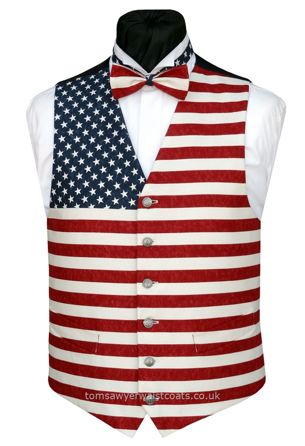 This american flag patriotic waistcoat features a mix of stars and stripes fabric for an eye catching look. The muted tones and cream stripe in this print give a vintage effect for a fun yet classy waistcoat, finished with a smart navy twill back. Waistcoat Style- TS469- Front Fabric- Cotton- Colour- Blue, white, red, cream- Buttons- Silver patterned- Back & Lining- Navy Twill- You can click here to view our waistcoat size chart. Featured shirt W....