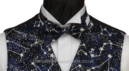 Pre-tied bowtie. The stars will glow in the dark. Style- Pre-Tied Bowtie- Colour- Blue and navy mottled background- Fabric- 100% Cotton-