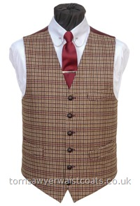 Made to order in our classic low neck style with two full pockets and one breast pocket, this versatile waistcoat could be worn to match with many colours as it has burgundy, moss green, tan, olive green and cream within the check pattern. The rich burgundy twill back help make this waistcoat a striking choice. Style- TS 507- Fabric- 70% wool, 30% polyester- Colour- Burgundy, moss green, olive green, tan & cream- Buttons- Brown leather- Back & Li....