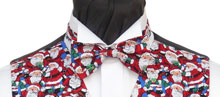 A Christmas bow tie featuring a crowd of Sparkling Santas. Style- TS540N Ready Tied Bow tie- Fabric- Cotton- Colour- Red, White and Royal Blue-