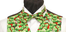 A Christmas bow tie featuring sprouts.....some with faces and antlers. Style- TS539N Ready Tied Bow tie- Fabric- Cotton- Colour- Green on a red background-
