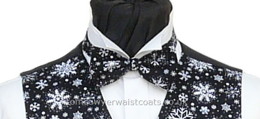 A Christmas ready tied bow tie with white snowflakes on a black background. - Style- TS554N Ready Tied Bow tie- Fabric- Cotton- Colour- Black and White-
