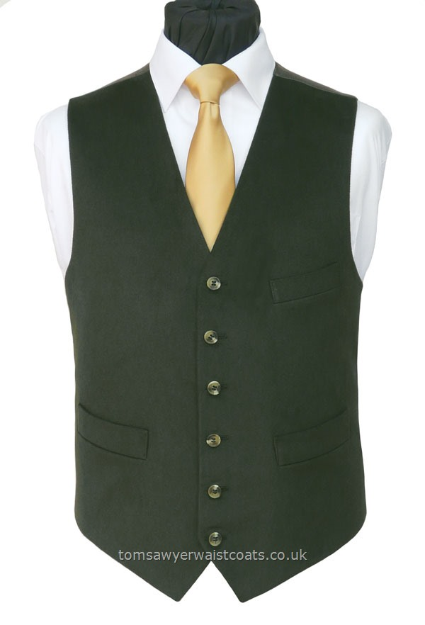 This dark /moss green cotton moleskin effect waistcoat is complimented by the ginger twill back. The close up image shown inis the closest representation of the colour of this waistcoat. Waistcoat Style- TS558- Front Fabric- 100% Cotton- Colour- Dark Moss Green - Buttons- Horn Effect- Back & Lining- Ginger Polyester Twill- You can click here to view our waistcoat size chart.