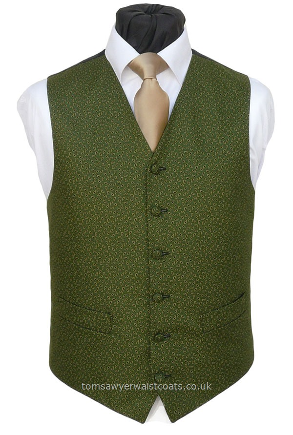 This lightweight cotton front waistcoat has our higher neckline and a neat paisley patterned front. - Waistcoat Style- TS549- Front Fabric- Cotton- Colour- Green and black Paisley- Buttons- Covered- Back & Lining- Black Polyester- You can click here to view our waistcoat size chart.