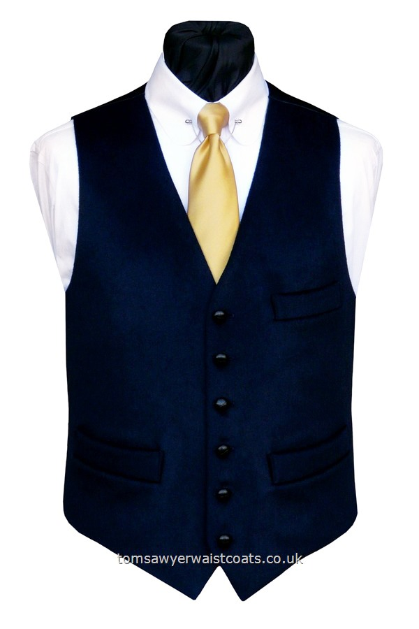 A 'smooth as velvet' moleskin waistcoat is a smart navy blue 100% cotton moleskin , featuring leather buttons, a lower cut, shaped neckline and additional breast pocket. This waistcoat is available in extra large sizes. Waistcoat Style- TS394- Front Fabric- 100% Cotton (Moleskin)- Colour- Navy Blue- Buttons- Black Leather- Back & Lining- Navy Polyester Twill- Moleskin is a heavy-napped cotton twill fabric which is popular for country apparel with....
