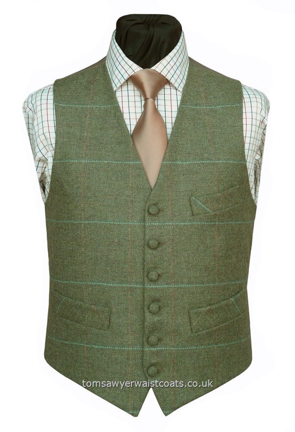 Front British Tweed, 100% Wool,woven in Yorkshire.A sage green tweed with an overcheck of rust, orange and light and dark blue with a buff coloured 'changeant' two tone twill back and lining. -Featuring a lower cut, shaped neckline and additional breast pocket. Waistcoat Style- TS425- Front Fabric- 100% Wool Tweed- Colour- Green, Blue, Rust, Orange- Buttons- Fabric covered- Back & Lining- Buff 'Changeant' Polyester Twill- You can click here to vi....