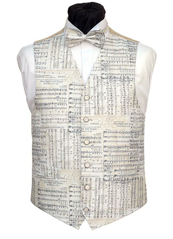 This stunning music themed waistcoat features sheet music. The ivory and cream colour is complimented by the rich cream back. Waistcoat Style- TS550- Front Fabric- Cotton- Colour- Ivory & Cream- Buttons- Cream with a silver rim- Back & Lining- Rich Cream Satin- You can click here to view our waistcoat size chart. Featured shirt White Wing Collar Shirt- -