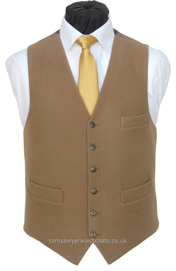 This 95% Merino wool and 5% cashmere waistcoat is suitable for formal and casual wear and is made to order in our classic low neck style with two full pockets and one breast pocket. The fabric is thick yet lightweight and as cuddly as a teddy bear! Style- TS 545- Fabric- 95% Merino Wool 5% Cashmere- Colour- Tan/Camel- Buttons- Antique brass effect- Back & Lining- Tan small paisley- Please choose the size you require.You can click here to view our....
