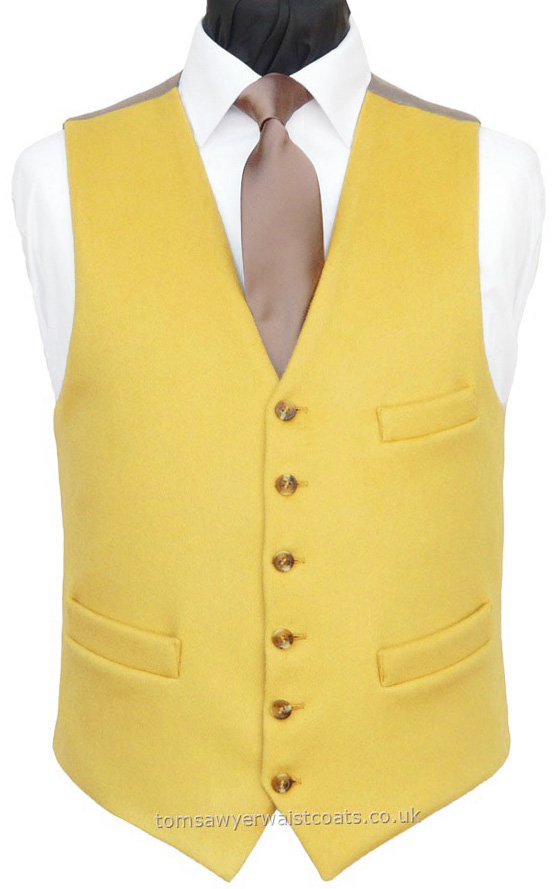 A 'smooth as velvet' wool doeskin waistcoat that's ideal for day wear. Featuring a lower cut, shaped neckline and breast pocket. - Waistcoat Style- TS217- Front Fabric- 100% Wool (Doeskin)- Colour- Yellow- Buttons- As shown- Back & Lining- Buff Twill- You can click here to view our waistcoat size chart.