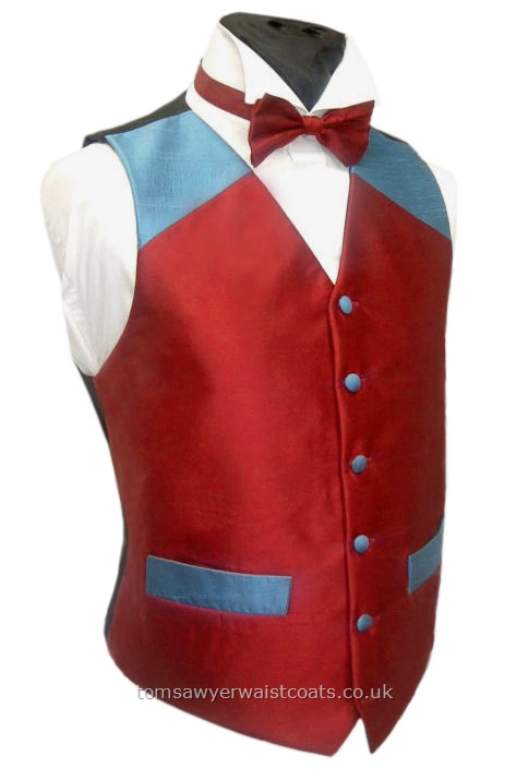 Let us know what YOUR club or team colours are and we'll design a unique waistcoat around them. You'll get to approve the actual colours and design prior to production. Price subject to final design. - Waistcoat Style- TS082- Front Fabric- Silk Dupion- Colour- Any combination-(featured waistcoat - Claret & Blue)- Buttons- Fabric covered- Back & Lining- Black polyester- Featured Neckwear- Pre-Tied Bowtie- Neckwear Fabric- Silk Dupion- Neckwear Col....