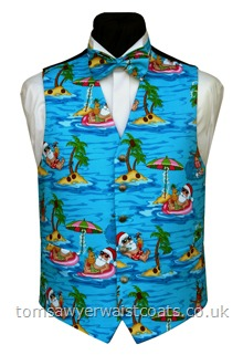 Santa and Rudolph's Tropical Holidays Waistcoat-This waistcoat features Santas relaxing on hammocks accompanied by a water-skiiing reindeer. All on an aqua coloured background. Waistcoat Style- TS458- Front Fabric- Cotton- Colour- Aqua with multicoloured print- Buttons- Silver Patterned - - Back & Lining- Black Polyester- You can click here to view our waistcoat size chart. -