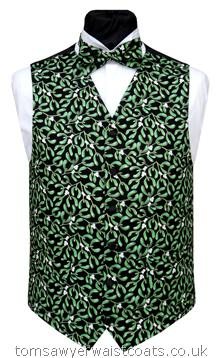 Mistletoe Waistcoat-Festive mistletoe with a subtle gold shimmer detail, scattered across a black background. Waistcoat Style- TS272- Front Fabric- Cotton- Colour- Mistletoe on black as shown- Buttons- Black Satin - Back & Lining- Black Polyester- You can click here to view our waistcoat size chart. -