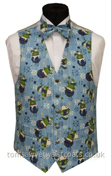Snowmen on Blue Christmas Waistcoat-Festive snowmen on a blue snowflake background. Waistcoat Style- TS385- Front Fabric- Cotton- Colour- Blue with multicoloured print- Buttons- Silver Patterned - - Back & Lining- Ivory Satin- You can click here to view our waistcoat size chart. -